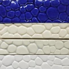 trim tile, pebble trim tile, pebble-look trim tile, hand made tile, ceramic tile